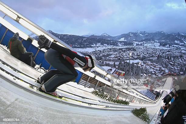 Simon Ammann of Switzerland competes on day 1 of the Four Hills Tournament Ski Jumping event at SchattenbergSchanze Erdinger Arena on December 27...