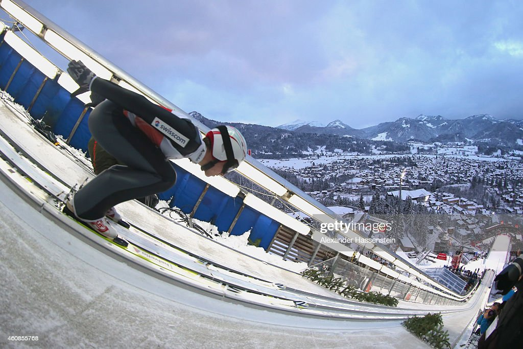 http://media.gettyimages.com/photos/simon-ammann-of-switzerland-competes-on-day-1-of-the-four-hills-ski-picture-id460855768
