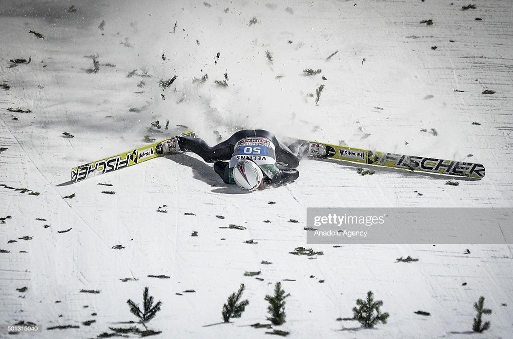 Simon Ammann of Switzerland crashes during his last jump at the final stage of the Four Hills ski jumping Tournament in Bischofshofen Austria on...