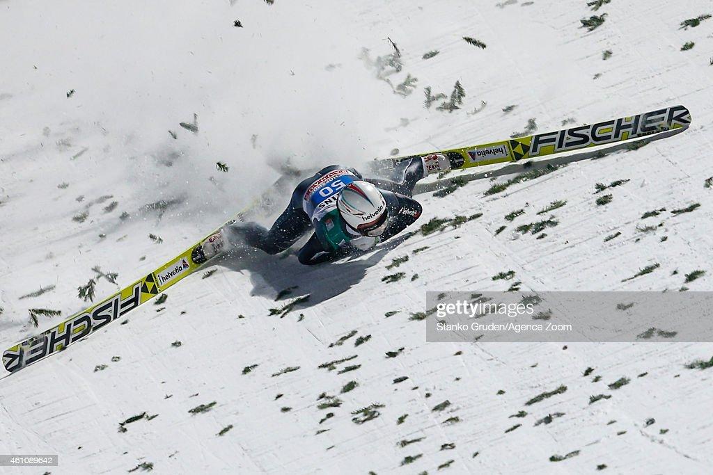 Simon Ammann of Switzerland falls during the FIS Ski Jumping World Cup Vierschanzentournee (Four Hills Tournament) on January 06, 2015 in Bischofhofen, Austria.