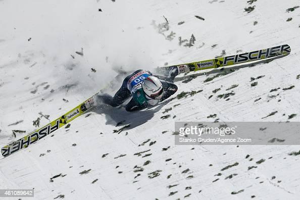 Simon Ammann of Switzerland falls during the FIS Ski Jumping World Cup Vierschanzentournee on January 06 2015 in Bischofhofen Austria