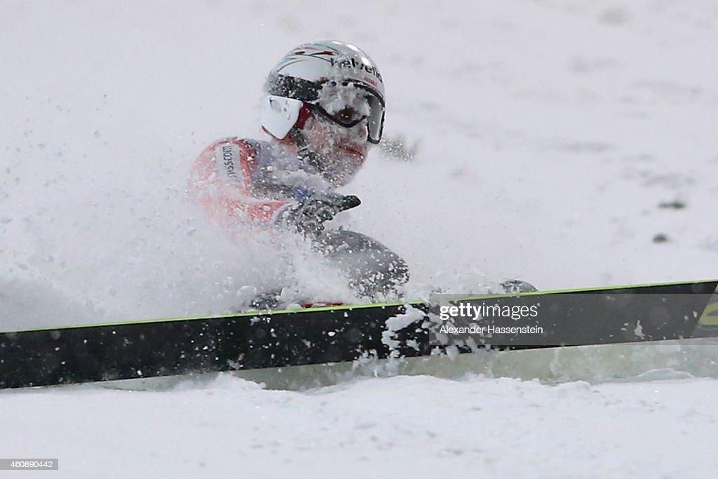 Simon Ammann of Switzerland falls on his first round jump on day 2 of the Four Hills Tournament Ski Jumping event at Schattenberg-Schanze Erdinger Arena on December 29, 2014 in Oberstdorf, Germany.