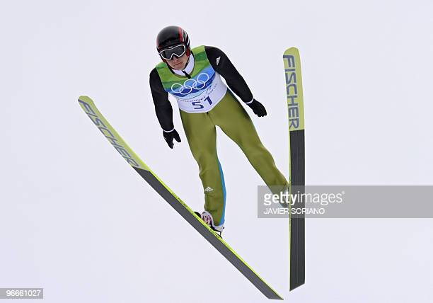 Simon Ammann of Switzerland flies through the air in the men's Ski Jumping normal hill final at the Whistler Olympic Park during the Vancouver Winter...