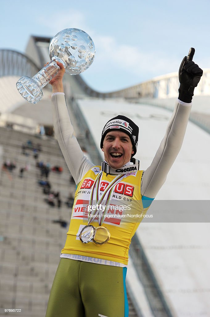 Simon Ammann of Switzerland holds up the Overall World Cup Bowl after the Ski Jumping HS 134 event in the FIS Ski Jumping World Cup on March 14 2010...