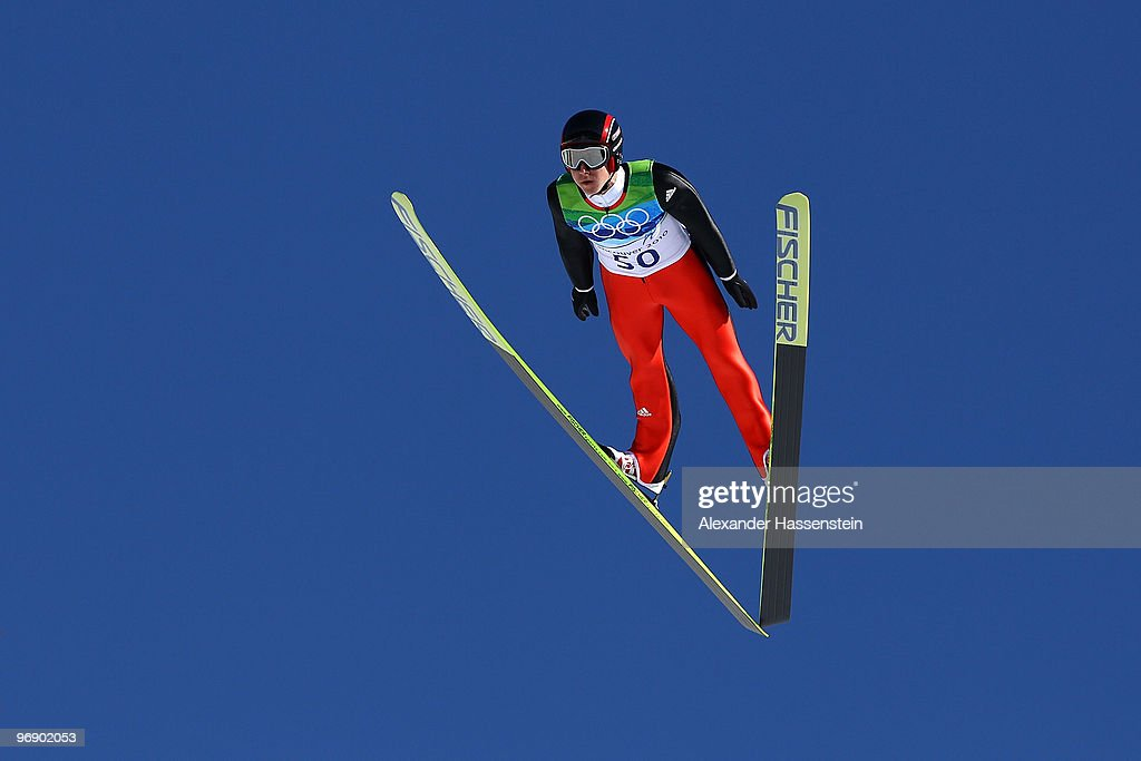 Simon Ammann of Switzerland soars off the Large Hill on day 9 of the 2010 Vancouver Winter Olympics at Ski Jumping Stadium on February 20 2010 in...