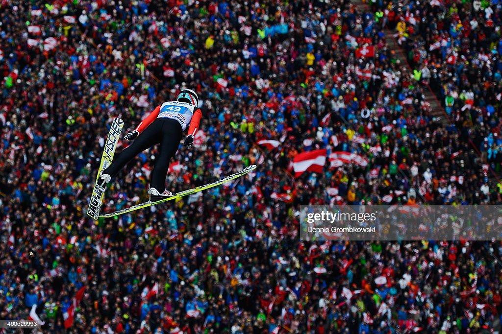 Simon Ammann of Switzerland soars through the air during his first round jump on day 2 of the Four Hills Tournament event at Bergisel on January 4...