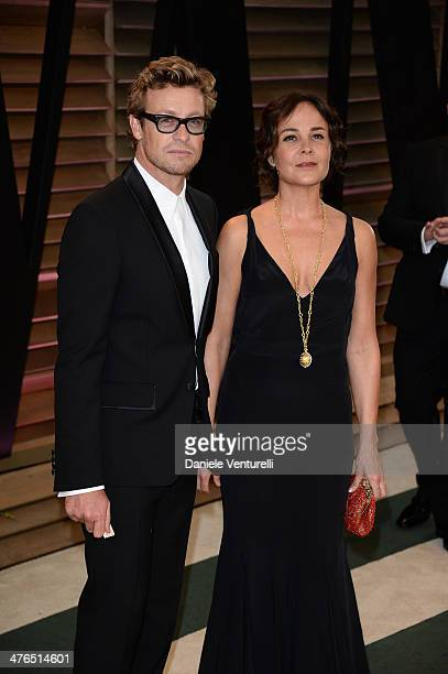 Simon Baker and Rebecca Rigg arrives at the 2014 Vanity Fair Oscar Party Hosted By Graydon Carter on March 2 2014 in West Hollywood California