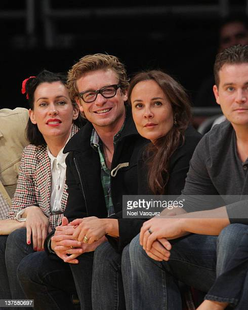 Simon Baker and Rebecca Rigg attend a game between the Indiana Pacers and the Los Angeles Lakers at Staples Center on January 22 2012 in Los Angeles...