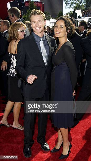 Simon Baker and wife Rebecca Rigg during The 54th Annual Primetime Emmy Awards Arrivals at The Shrine Auditorium in Los Angeles California United...