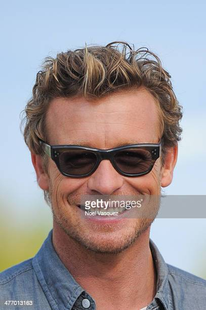 Simon Baker visits 'Extra' at Universal Studios Hollywood on March 6 2014 in Universal City California