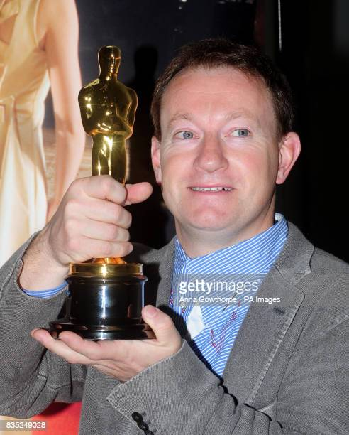 Simon Beaufoy script writer for Slumdog Millionaire with the Oscar he won for Best Adapted Screenplay during a photocall at the National Media Museum...