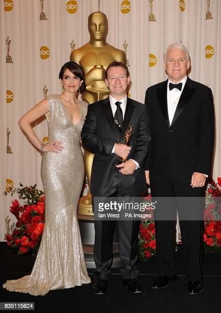 Simon Beaufoy with the Best Adapted Screenplay award with Tina Fey and Steve Martin received for Slumdog Millionaire at the 81st Academy Awards at...