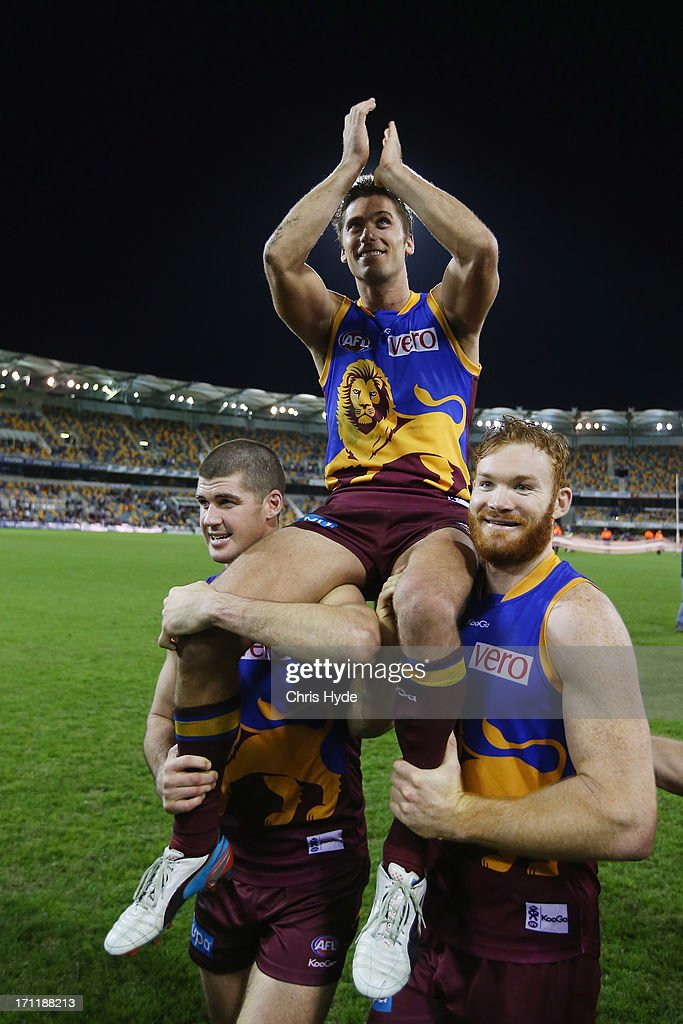 <a gi-track='captionPersonalityLinkClicked' href=/galleries/search?phrase=Simon+Black&family=editorial&specificpeople=217266 ng-click='$event.stopPropagation()'>Simon Black</a> of the Lions is chaired off by team mates <a gi-track='captionPersonalityLinkClicked' href=/galleries/search?phrase=Jonathan+Brown+-+Australian+Rules+Football+Player&family=editorial&specificpeople=12934842 ng-click='$event.stopPropagation()'>Jonathan Brown</a> and Daniel Merrett after his 320th game during the round 13 AFL match between the Brisbane Lions and the Geelong Cats at The Gabba on June 23, 2013 in Brisbane, Australia.