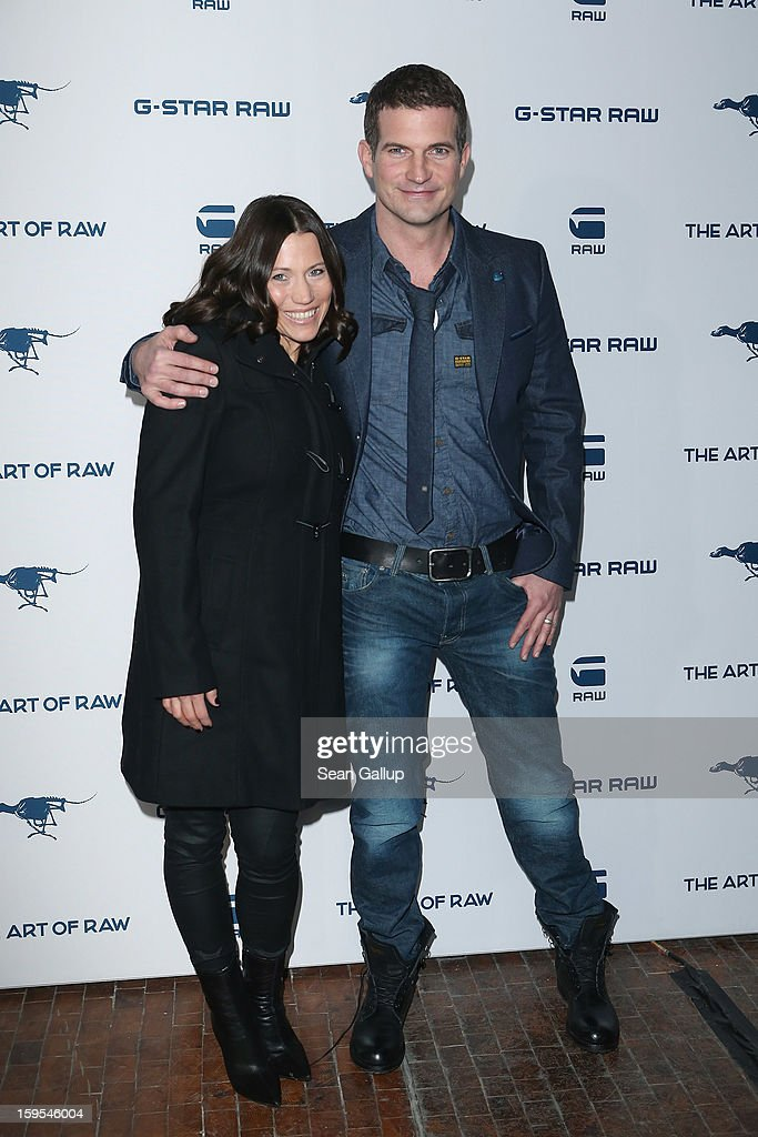 Simon Boeer and his wife Anna attend the G-Star Autumn/Winter 2013 runway show at St. Agnes Church on January 15, 2013 in Berlin, Germany.