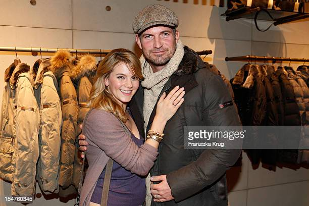 Simon Boeer and Luise Baehr attend the opening of the 'Peuterey' store on October 25 2012 in Berlin Germany