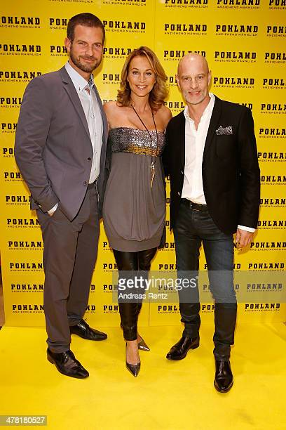 Simon Boeer Caroline Beil and Simon Licht attend the Pohland store opening on March 12 2014 in Dortmund Germany