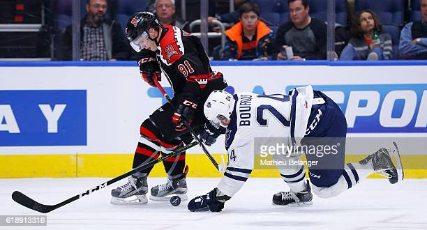 Simon Bourque of the Rimouski Oceanic and Matthew Boucher of the Quebec Remparts battle for the puck during their QMJHL hockey game at the Centre...