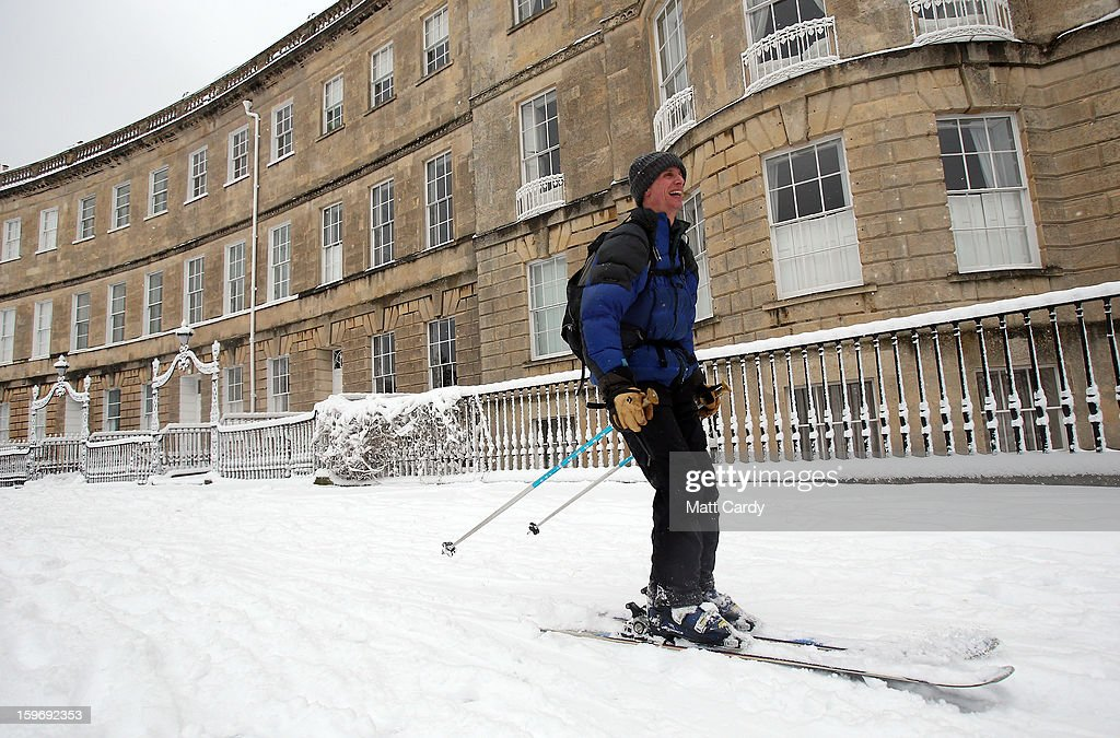 Simon Brand uses the snow to ski along Lansdown Crescent on January 18, 2013 in Bath, England. Heavy snow is bringing widespread disruption to many parts of the UK.