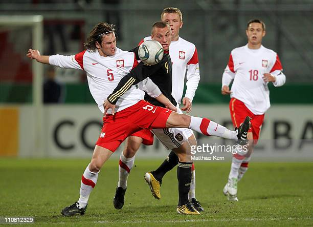Simon Brandstetter of Germany battles for the ball with Grzegorz Krychowiak of Poland during the U20 friendly match between Germany and Poland at...