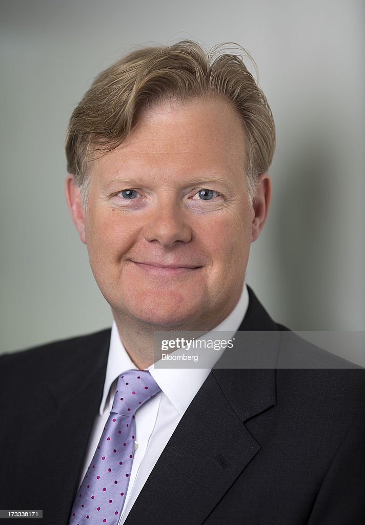 Simon Calver, chief executive officer of Mothercare Plc, poses for a photograph following a Bloomberg Television interview in London, U.K., on Friday, July 12, 2013. U.K. consumer confidence rose to its highest in more than two years in June as a brightening economy made Britons more willing to spend on big-ticket items. Photographer: Simon Dawson/Bloomberg via Getty Images
