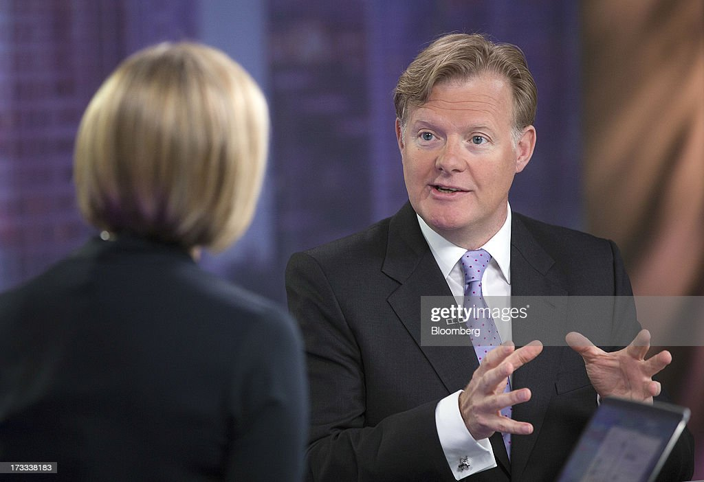 Simon Calver, chief executive officer of Mothercare Plc, right, gestures as he speaks during a Bloomberg Television interview in London, U.K., on Friday, July 12, 2013. U.K. consumer confidence rose to its highest in more than two years in June as a brightening economy made Britons more willing to spend on big-ticket items. Photographer: Simon Dawson/Bloomberg via Getty Images