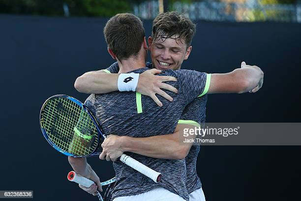 Simon Carr of Ireland and Max Stewart of Great Britain celebrate winning their first round match against Dan Added of France and Matteo Martineau of...