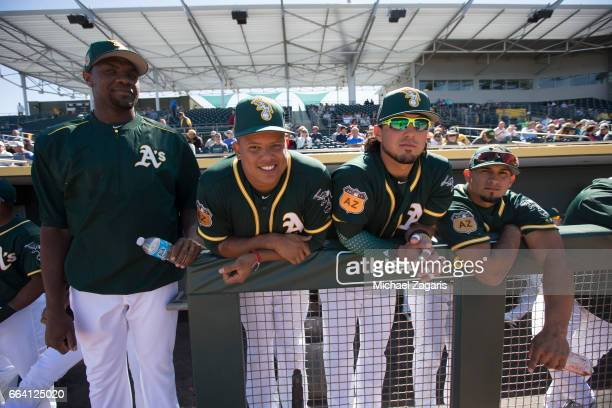 Simon Castro Yairo Munoz Raul Alcantara and Franklin Barreto of the Oakland Athletics stand in the dugout prior to the game against the Texas Rangers...