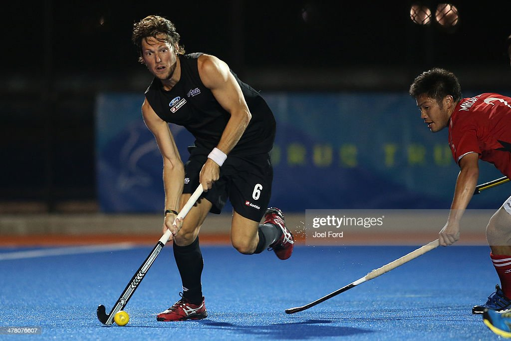 Simon Child of New Zealand runs with the ball during the Test Match between the New Zealand Black Sticks and Japan at Blake Park on March 12, 2014 in Mount Maunganui, New Zealand.
