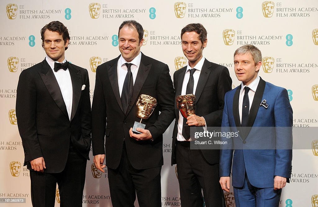 Simon Chinn (2nd from L) and Malik Bendjelloul (2nd from R) , winners of the Documentry award for 'Searching For Sugar Man', pose in the press room with presenters Henry Cavill (L) and Martin Freeman (R) at the EE British Academy Film Awards at The Royal Opera House on February 10, 2013 in London, England.