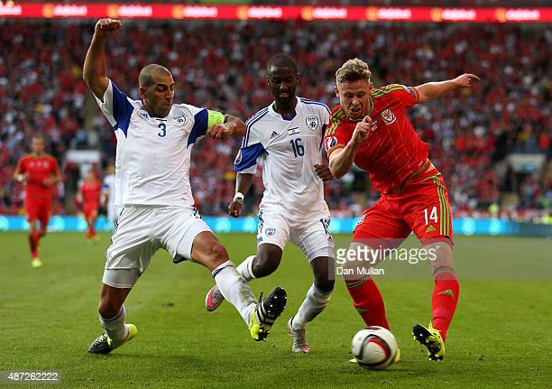 Simon Church of Wales takes on Tal Ben Haim I of Israel and Eli Dasa of Israel during the UEFA EURO 2016 Qualifying Match between Wales and Israel at...