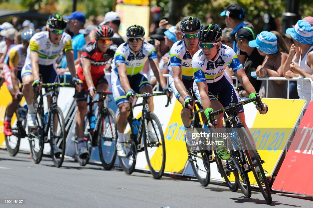 Simon Clarke (R) of Australia leads the GreenEdge team during the 90-km stage 6 around the streets of Adelaide on the final day of the Tour Down Under cycling race on January 27, 2013. AFP PHOTO / Mark Gunter USE
