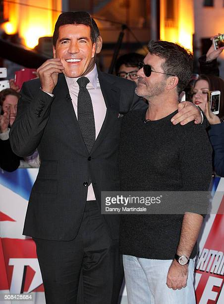 Simon Cowell and David Walliams play with a Simon Cowell face mask before the Britain's Got Talent Birmingham auditions on February 4 2016 in...