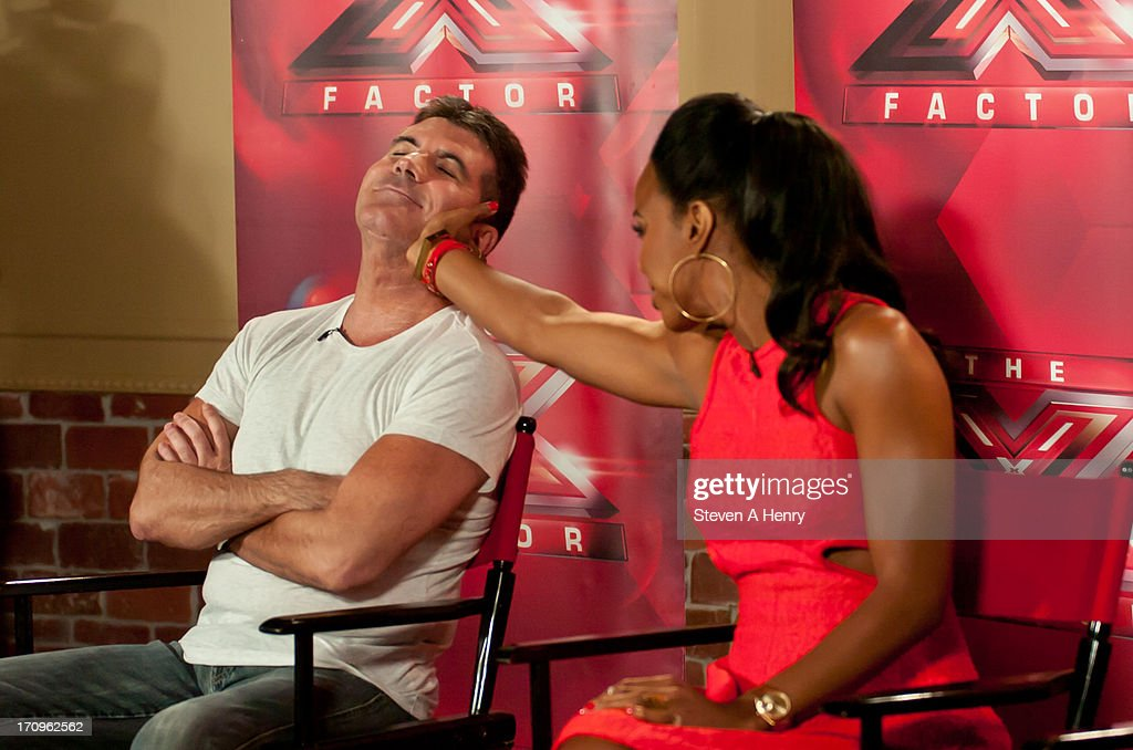 Simon Cowell and Kelly Rowland attend the 'The X Factor' Judges press conference at Nassau Veterans Memorial Coliseum on June 20, 2013 in Uniondale, New York.