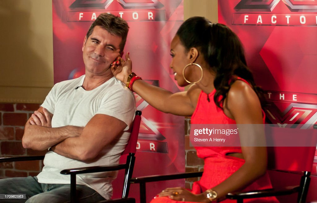 <a gi-track='captionPersonalityLinkClicked' href=/galleries/search?phrase=Simon+Cowell&family=editorial&specificpeople=203007 ng-click='$event.stopPropagation()'>Simon Cowell</a> and <a gi-track='captionPersonalityLinkClicked' href=/galleries/search?phrase=Kelly+Rowland&family=editorial&specificpeople=201760 ng-click='$event.stopPropagation()'>Kelly Rowland</a> attend the 'The X Factor' Judges press conference at Nassau Veterans Memorial Coliseum on June 20, 2013 in Uniondale, New York.