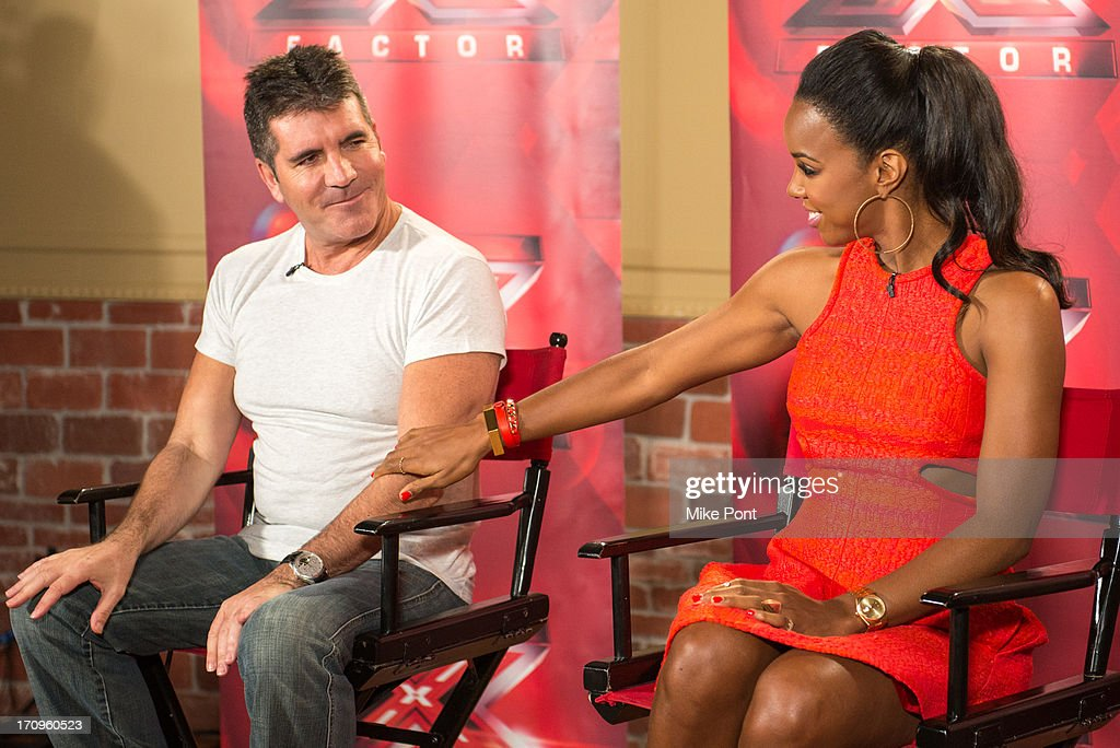 Simon Cowell and Kelly Rowland attend 'The X Factor' Judges press conference at Nassau Veterans Memorial Coliseum on June 20, 2013 in Uniondale, New York.