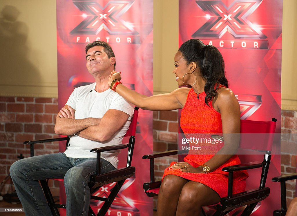 <a gi-track='captionPersonalityLinkClicked' href=/galleries/search?phrase=Simon+Cowell&family=editorial&specificpeople=203007 ng-click='$event.stopPropagation()'>Simon Cowell</a> and <a gi-track='captionPersonalityLinkClicked' href=/galleries/search?phrase=Kelly+Rowland&family=editorial&specificpeople=201760 ng-click='$event.stopPropagation()'>Kelly Rowland</a> attend 'The X Factor' Judges press conference at Nassau Veterans Memorial Coliseum on June 20, 2013 in Uniondale, New York.