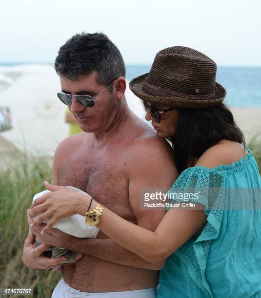 Simon Cowell and Lauren Silverman are seen with their newborn son Eric Cowell while at the beach on February 24 2014 in Miami Florida