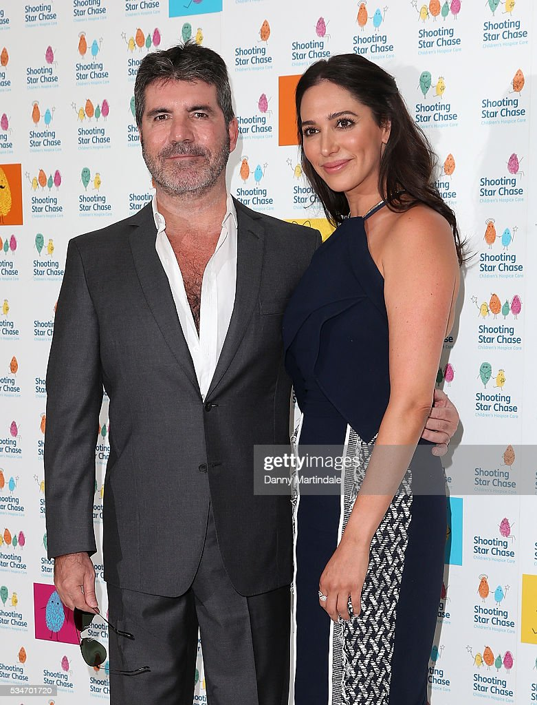 <a gi-track='captionPersonalityLinkClicked' href=/galleries/search?phrase=Simon+Cowell&family=editorial&specificpeople=203007 ng-click='$event.stopPropagation()'>Simon Cowell</a> and <a gi-track='captionPersonalityLinkClicked' href=/galleries/search?phrase=Lauren+Silverman&family=editorial&specificpeople=4501937 ng-click='$event.stopPropagation()'>Lauren Silverman</a> arrive for Star Chase Children's Hospice Event at The Dorchester on May 27, 2016 in London, England.