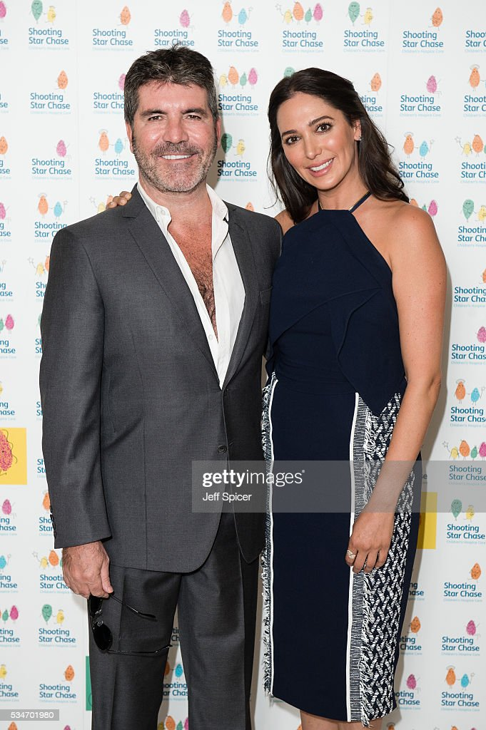 Simon Cowell and Lauren Silverman arrive for Star Chase Children's Hospice Event at The Dorchester on May 27, 2016 in London, England.