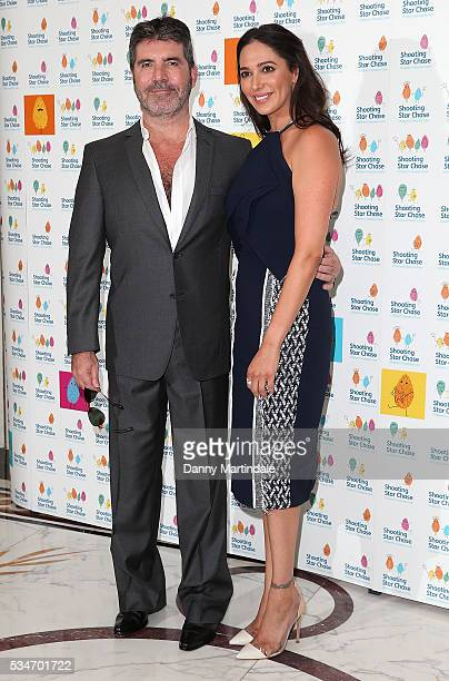 Simon Cowell and Lauren Silverman arrives for Star Chase Children's Hospice Event at The Dorchester on May 27 2016 in London England