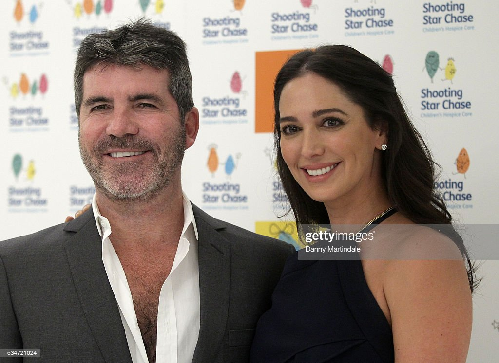 <a gi-track='captionPersonalityLinkClicked' href=/galleries/search?phrase=Simon+Cowell&family=editorial&specificpeople=203007 ng-click='$event.stopPropagation()'>Simon Cowell</a> and <a gi-track='captionPersonalityLinkClicked' href=/galleries/search?phrase=Lauren+Silverman&family=editorial&specificpeople=4501937 ng-click='$event.stopPropagation()'>Lauren Silverman</a> arrives for Star Chase Children's Hospice Event at The Dorchester on May 27, 2016 in London, England.