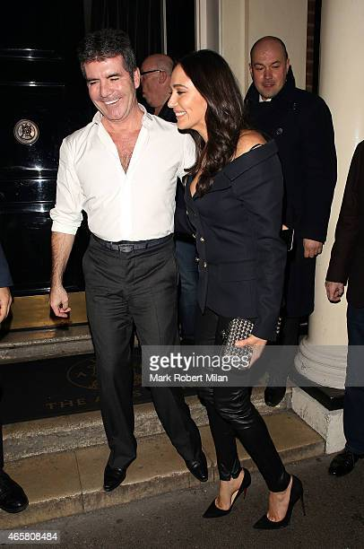 Simon Cowell and Lauren Silverman at the Arts Club on March 10 2015 in London England