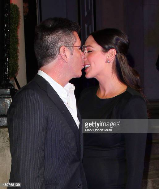 Simon Cowell and Lauren Silverman at the I Can't Sing opening night party held at One Marylebone on March 26 2014 in London England