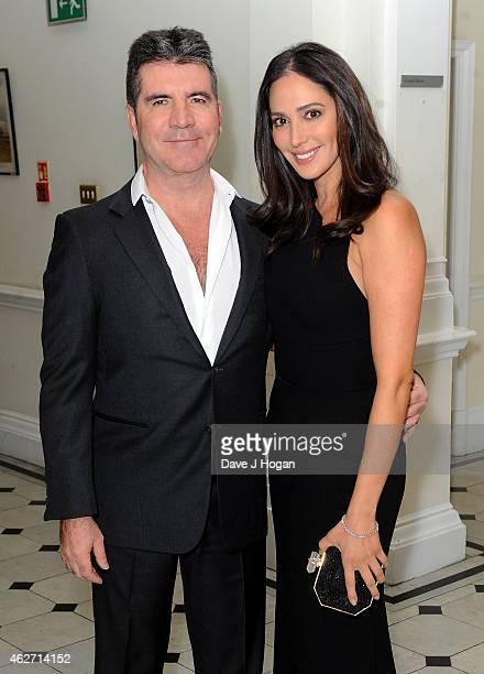 Simon Cowell and Lauren Silverman attend the British Asian Trust dinner at Banqueting House on February 3 2015 in London England