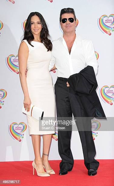 Simon Cowell and Lauren Silverman attend the Health Lottery tea party at The Savoy Hotel on June 2 2014 in London England