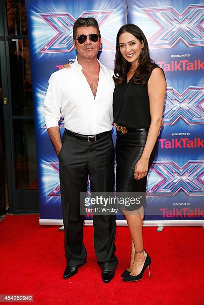 Simon Cowell and Lauren Silverman attend the press launch for the new series of 'The X Factor' at Ham Yard Hotel on August 27 2014 in London England
