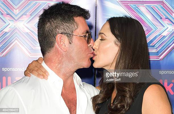 Simon Cowell and Lauren Silverman attends the press launch for the new series of 'The X Factor' at Ham Yard Hotel on August 27 2014 in London England