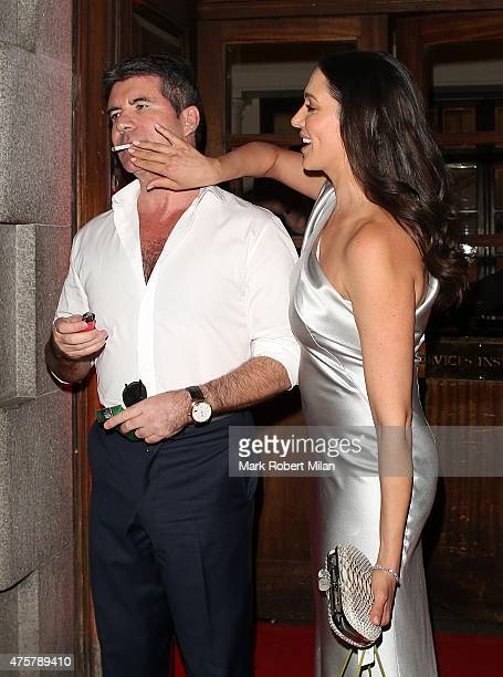 Simon Cowell and Lauren Silverman leaving the Banqueting House Whitehall on June 3 2015 in London England