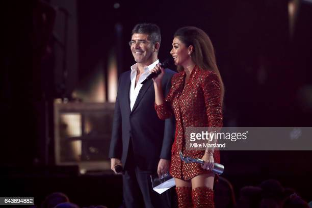 Simon Cowell and Nicole Scherzinger present the award for Best British Artist Video of the Year on stage at The BRIT Awards 2017 at The O2 Arena on...
