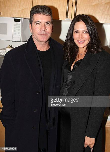 Simon Cowell and partner Lauren Silverman pose backstage at 'BEAUTIFUL The Carole King Musical' on Broadway at The Stephen Sondheim Theater on...
